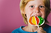 Boy eating lollipop, portrait