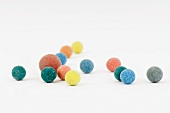 Colorful balls scattered over white surface