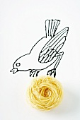 Drawing of bird carrying real nest of pasta