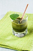 A glass of wheatgrass juice