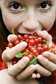 Girl holding redcurrants
