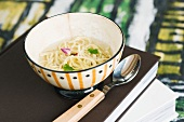 Chicken and rose soup with spaghettini