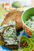 Spiced toast topped with a goat's cheese and herb spread