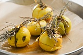 Small baked apples with herbs