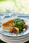 A slice of vegetable quiche with salad