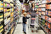 A woman and her son shopping in a supermarket