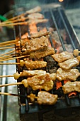 Pork kebabs on a grill
