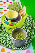 Lettuce soup and picnic bowls and plates
