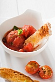 Tomato and basil sorbet with strips of toast