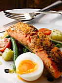 Fried, marinated salmon with salade Nicoise and a soft boiled egg