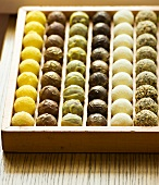 Assorted truffles in a wooden chocolate box