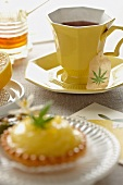 Marijuana Tea in a Yellow Tea Cup; Mini Lemon Pie