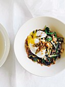 Braised lettuce with anchovies and a poached egg
