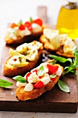 Artichoke bruschetta and tomato and mozzarella bruschetta