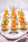 Mini blinis with creme fraiche and caviar