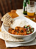Chicken tikka with rice and naan bread
