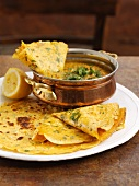 Coriander pancakes with dal