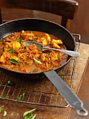 Fish curry in a pan