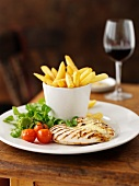 Chicken breast with garlic, chips and a glass of red wine