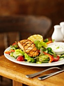 Grilled salmon fillet with a mixed leaf salad