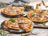 Three different stone oven pizzas