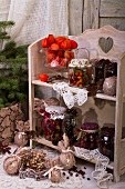 Storage jars and Christmas decorations on a small shelf