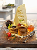 Crackers and dips with cheddar cheese on a table