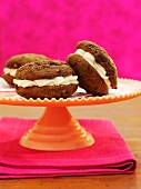 Chocolate and ginger whoopie pies filled with cream