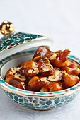 Hazelnut brittle in a porcelain bowl