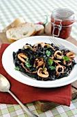Black tagliatelle with squid and chilli sauce