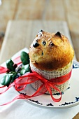 Mini panettone tied with ribbon on a plate