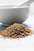 Organic Golden Flax Seeds; Mortar and Pestle