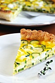 A slice of courgette and ricotta quiche on a plate