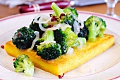 A slice of fried polenta topped with broccoli and chilli