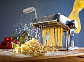 Fresh pasta being dusted with flour