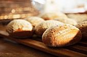Bread rolls on a wooden rack