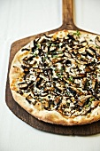 Portobello Mushroom and Scamorza Cheese Pizza on a Pizza Paddle