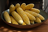 Ears of Shucked Organic Corn Cobs in a Bowl