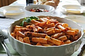 Rigatoni with tomato sauce in a porcelain bowl