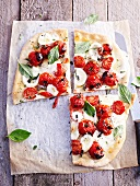 Mozzarella and tomato pizza with basil
