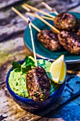 Meat kebabs with a broad bean puree