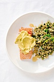 Grilled salmon with avocado cream served with orzo and pesto