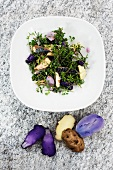 Wild herb salad with fish and a trio of potatoes