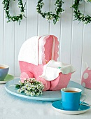A sweet pram with raspberry icing