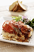 Fish steak gratinated with tomatoes and mozzarella
