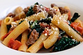 Rigatoni with spinach, sausage and tomatoes