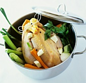 Soup chicken and vegetables in a pot