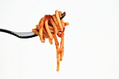 A fork of spaghetti with tomato sauce