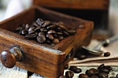 Coffee beans in an old coffee mill
