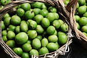 Freshly picked green walnuts in baskets